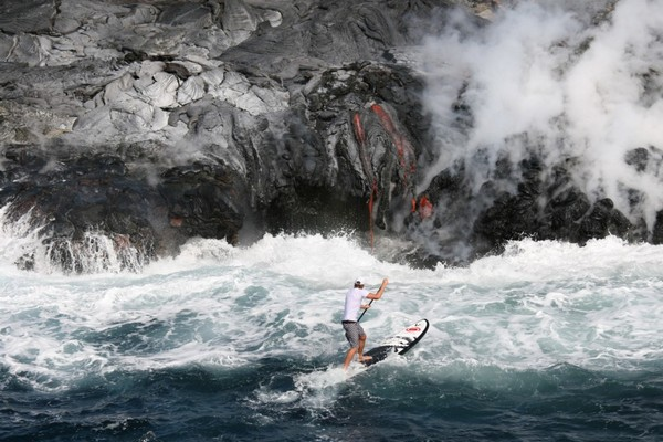 PRO SURFER GETS UP CLOSE AND PERSONAL WITH MOLTEN LAVA!